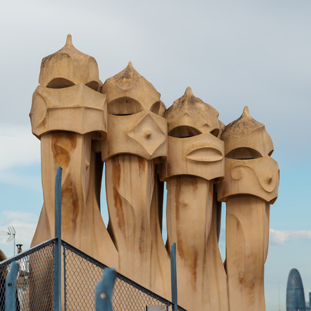 BARCELONA, SPAIN - MAY 31, 2014: Chimneys on rooftop of Gaudis masterpiece Casa Batlo. The building that is now Casa Batllo was built in 1877 by Antoni Gaudi, commissioned by Lluis Sala Sanchez. Editorial