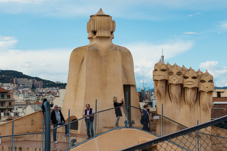 BARCELONA, SPAIN - MAY 31, 2014: Tourists on rooftop of Gaudi's masterpiece Casa Batlo. The building that is now Casa Batllo was built in 1877 by Antoni Gaudi, commissioned by Lluis Sala Sanchez.