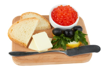 Served caviar, with butter and toasts  isolated on white  photo