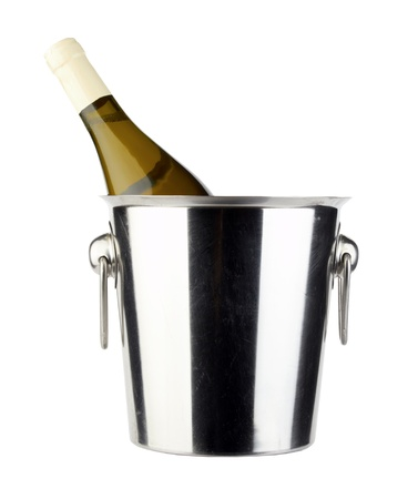 bottle of white vine in cold ice bucket  isolated on white  photo