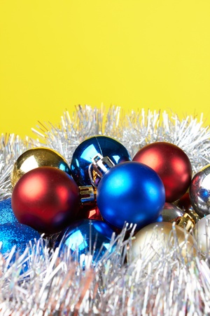 Christmas decorations on yellow background  photo