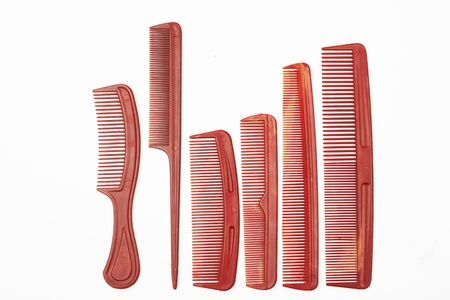 plastic comb: Assorted plastic combs on white background  Stock Photo
