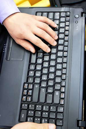 Close-up of male hands lying on the keyboard Stock Photo - 11327420