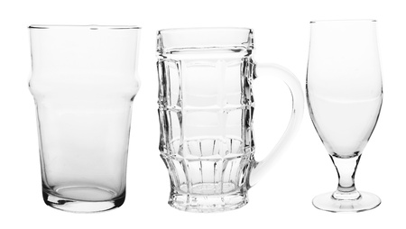 three of empty beer glasses isolated on white
