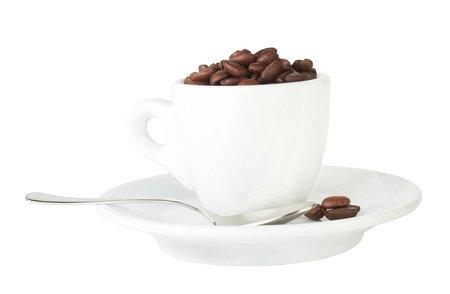pour coffee grounds into the cup is isolated on a white background photo