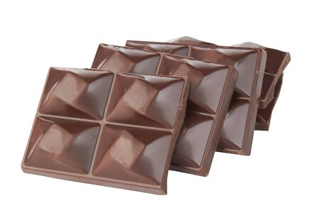 Stacked dark chocolate isolated on a white