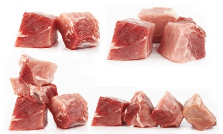 Pieces of fresh raw meat  on white background  photo