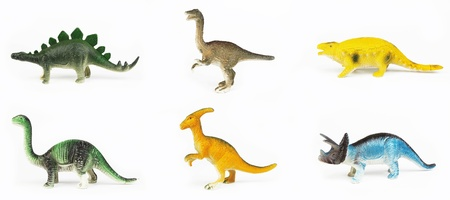 Toy dinosaurs on white background Imagens