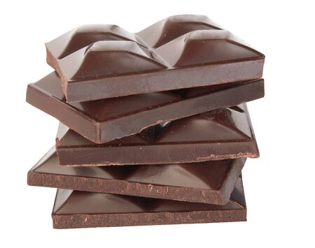 Stacked dark chocolate isolated on a white  photo