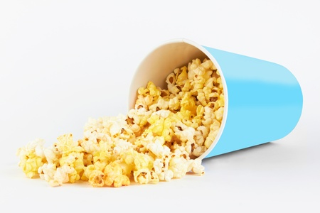 fresh popcorn in container on a white photo