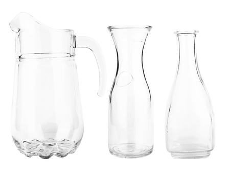 Collection of glass decanters isolated on a white photo