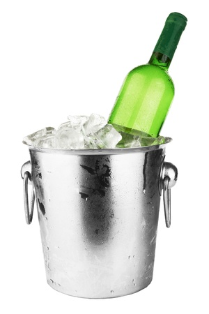White wine bottle in cold ice bucket. Isolated on white  Imagens