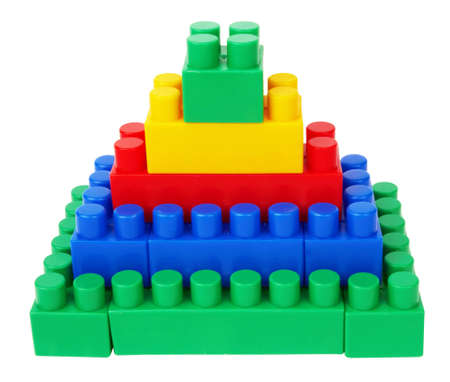 plastic building blocks pyramid on a white background  Stock Photo - 12371492