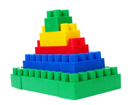 plastic building blocks pyramid on a white background Stock Photo - 12371360