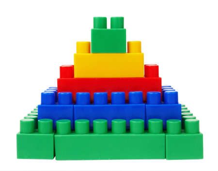 plastic building blocks pyramid on a white background  Stock Photo - 12371495