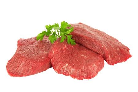 Stukken van verse rauwe vlees op een witte achtergrond Stockfoto