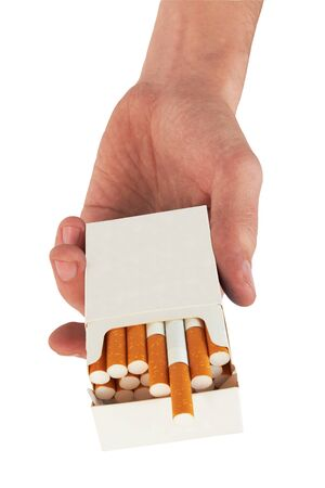 Pack of cigarettes in hand, isolated on white background  photo