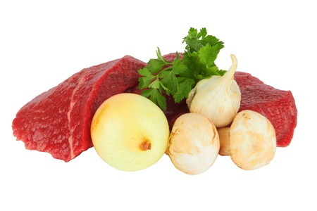 raw meat and vegetables on white photo