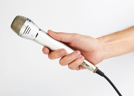 hand with a microphone on white
