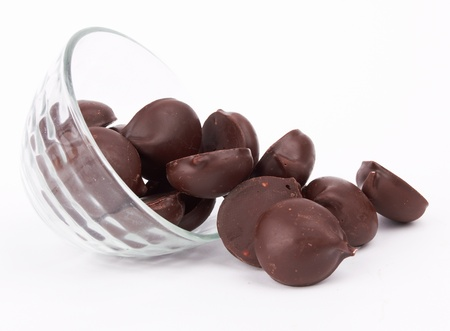 chocolate candy  in bowl on white Stock Photo