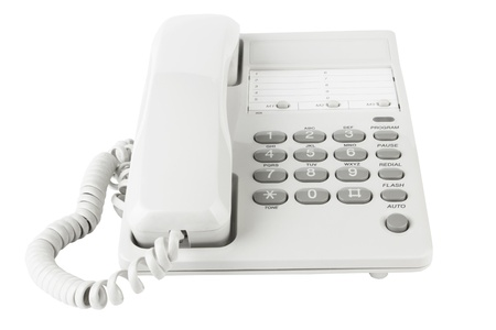 landlines: White office telephone isolated on a white background  Stock Photo