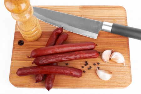 Sausage on board on white background Stock Photo - 13628236