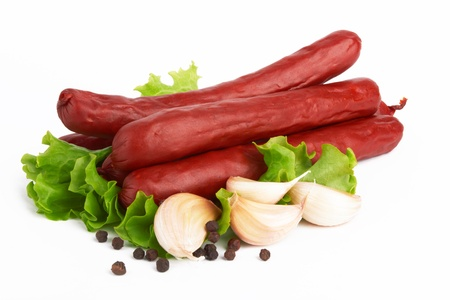 Sausage arranged with lettuce on white background Stock Photo - 13628116