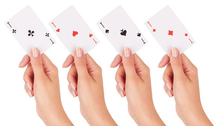Playing card in hand isolated on white background  photo