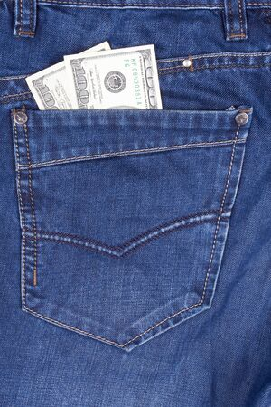 closeup dollars in a jeans pocket  photo