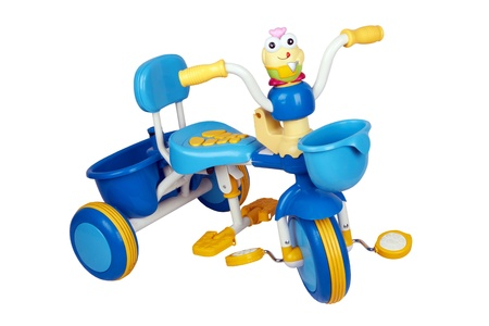 A childs tricycle isolated on a white background