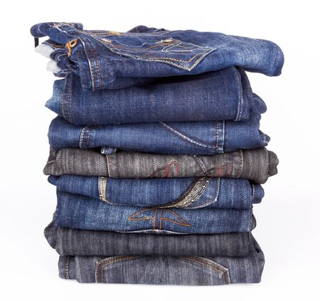 Lot of different  jeans close-up isolated on white Stock Photo - 15616102