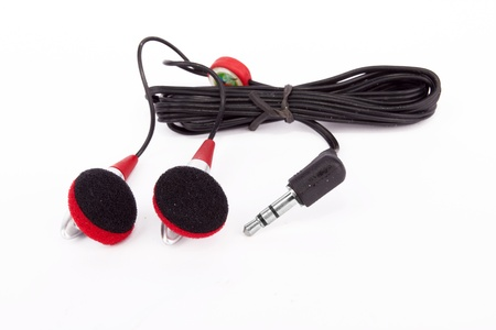 Modern portable audio earphones on white Stock Photo - 15844282