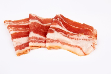 sliced pork bacon isolated on white background