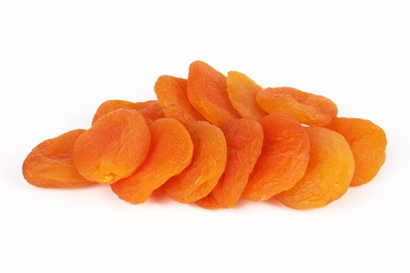 Dried apricots on a white background photo