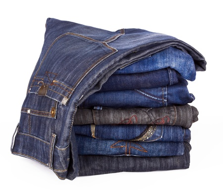 Lot of different jeans close-up isolated on white Stock Photo - 16052252