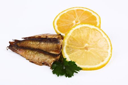 inhibited: Smoked sprats in oil on white background  Stock Photo