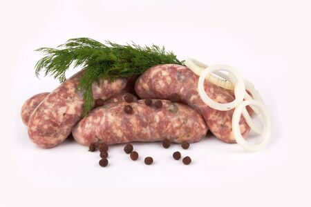 llonganissa: pile of pork meat sausages on a white background Stock Photo