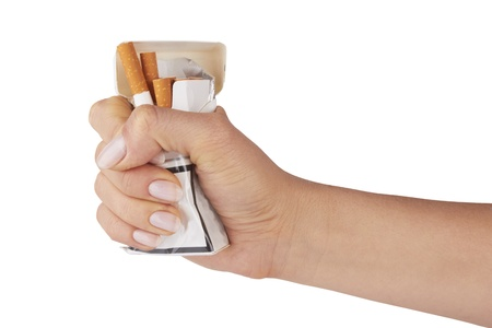 stop smoking fist with crushed pack of cigarettes