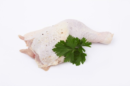 Fresh chicken drumstick on white  photo