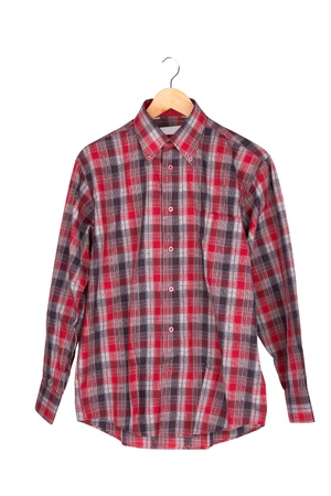 Red checkered shirt on wooden hanger  isolated on white  Stock Photo - 17113443