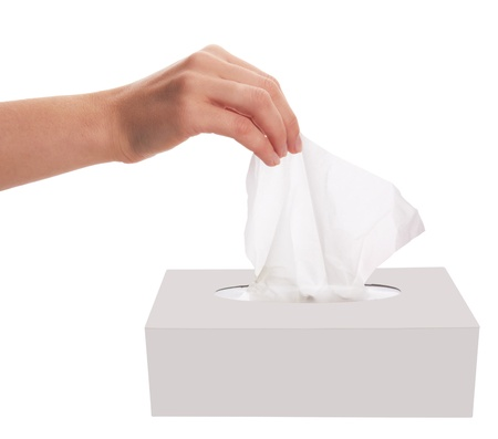 female hand pulling white facial tissue from a box
