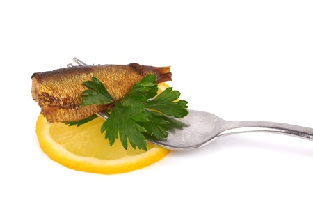 Smoked sprats with  fork and lemon Stock Photo - 17581590