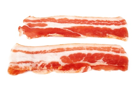 Fresh sliced bacon on white background