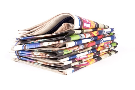 pack of newspapers on white background