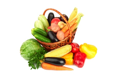 Basket with vegetables on white  photo