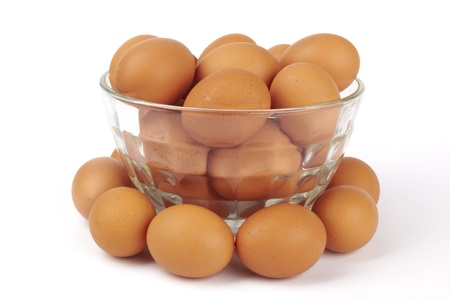 brown eggs in transparent bowl isolated on white  Stock Photo