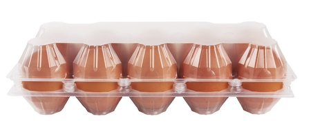 Eggs in plastic box isolated photo