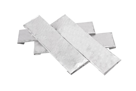 chewing gums wrapped in standard silver foil, isolated on white  photo