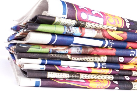 Close-up shot of stack of newspapers for recycle on white background  photo