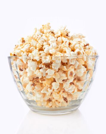 Bowl of popcorn, isolated on a whine background